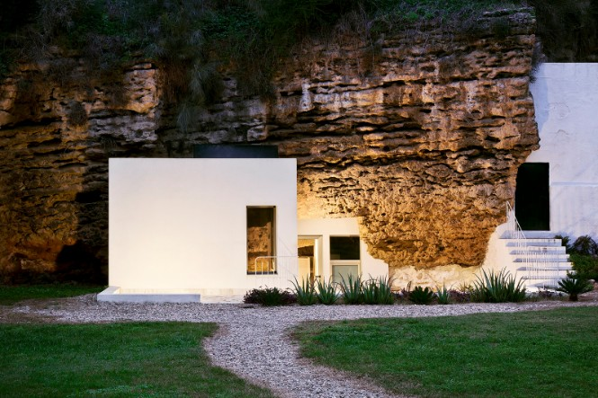 Cave House Straight Out of a Fairy Tale with a Stunning Floor Lamp 1